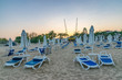 Chairs and umbrellas on a beautiful beach at sunset in Sunny Beach on the Black Sea coast of Bulgaria
