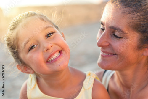 Valokuva  little girl smiling with her mother