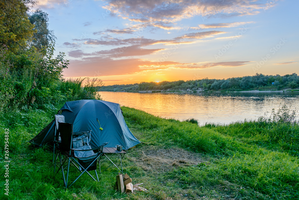 Fototapety, obrazy: Camping tent in a camping in forest by the river