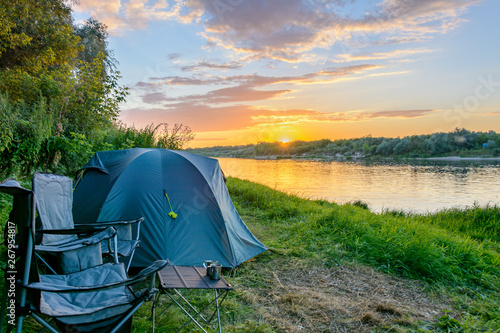Poster Camping Tourism equipment. Camping tent, tourist chairs in camping by the river