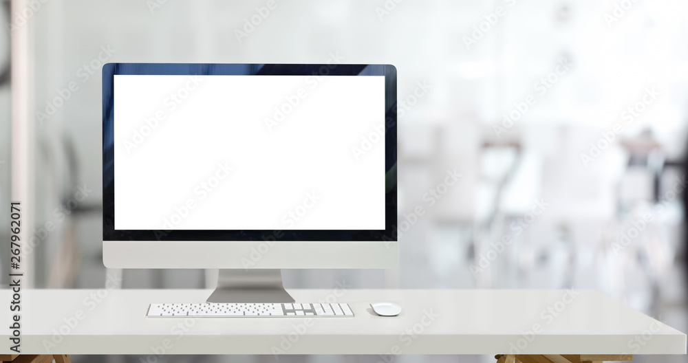 Fototapeta Mock up desktop computer and blank screen display in office