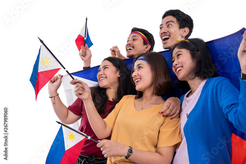 excited asian young supporter holding philippines flag over white background Canvas Print