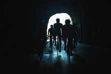 Silhouette Of Athletes On Bicy...