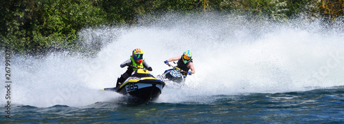 Garden Poster Water Motor sports Jet Ski Racers in competitive event on lake making a lot of spray.
