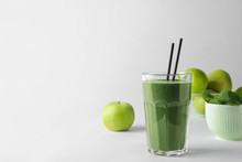 Glass Of Spirulina Smoothie, Apples And Spinach On White Background. Space For Text