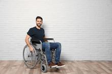 Young Man In Wheelchair Near B...