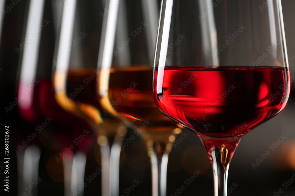 Fototapety, obrazy: Row of glasses with different wines on blurred background, closeup