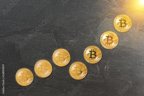 Rising chart made of gold bitcoin coins, concept of