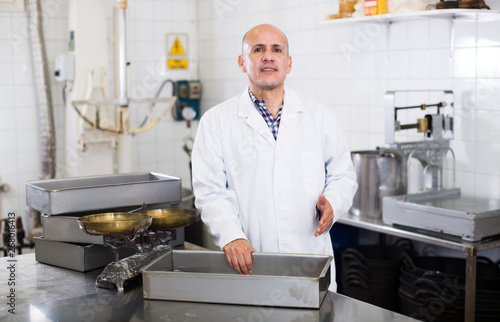 Fotografie, Obraz  Middle aged worker standing near the table