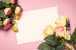 canvas print picture - Empty paper sheet and flowers on pink background.