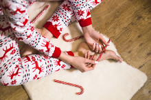 Person Holding Candy Cane Inside Room