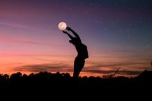 Silhouette Of Woman Raising He...