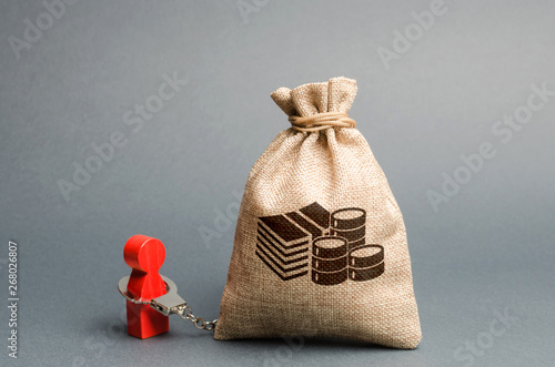 A person is handcuffed with a money bag Fototapet