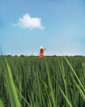 Woman Standing On Green Field During Daytime