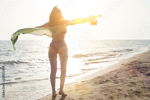 beautiful woman swim wear at the beach in sunny summer