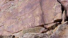 Wide Panning View Of Petroglyp...