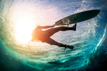 Underwater View Of The Male Surfer After He Fell Into The Water