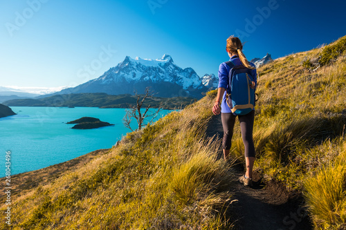 Tablou Canvas Woman hiker walks on the trail in the Torres del Paine National Park