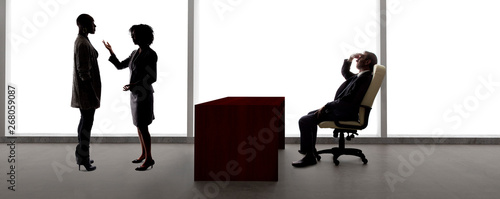 Black African American actress and scene partner auditioning for a role to a male casting director in a studio.  The actors are silhouettes and depicts the Hollywood entertainment industry.