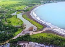 River Delta Meet The Blue Calm Ocean. Muddy River Flow Its Sediment Into Seashore Or Beach. Aerial View Of Ciletuh Bay At Sukabumi Pelabuhanratu