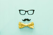 Leinwandbild Motiv Father's day concept. Hipster glasses, mustache and bow tie on wooden background. top view, flat lay