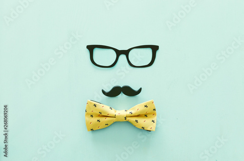 Tuinposter Londen Father's day concept. Hipster glasses, mustache and bow tie on wooden background. top view, flat lay