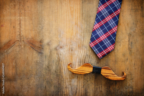 Canvas Prints Textures Father's day concept. Necktie and mustache over wooden background. top view, flat lay