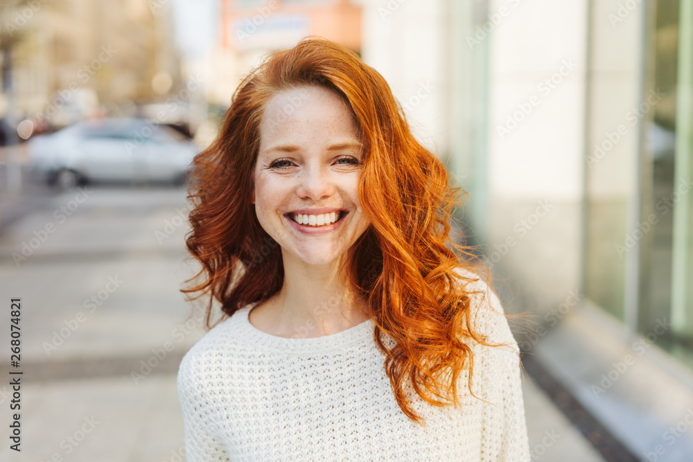 Fototapeta Happy friendly attractive young woman