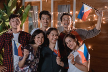 Friend Celebrating Philippines National Independence Day Party At Night In The Home Backyard Together