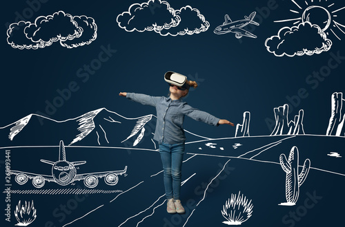 Painted dream about flying as an aircraft in desert. Little girl or child with virtual reality headset glasses. Concept of cutting edge technology, video games, innovation, childhood, dreams. - 268093441