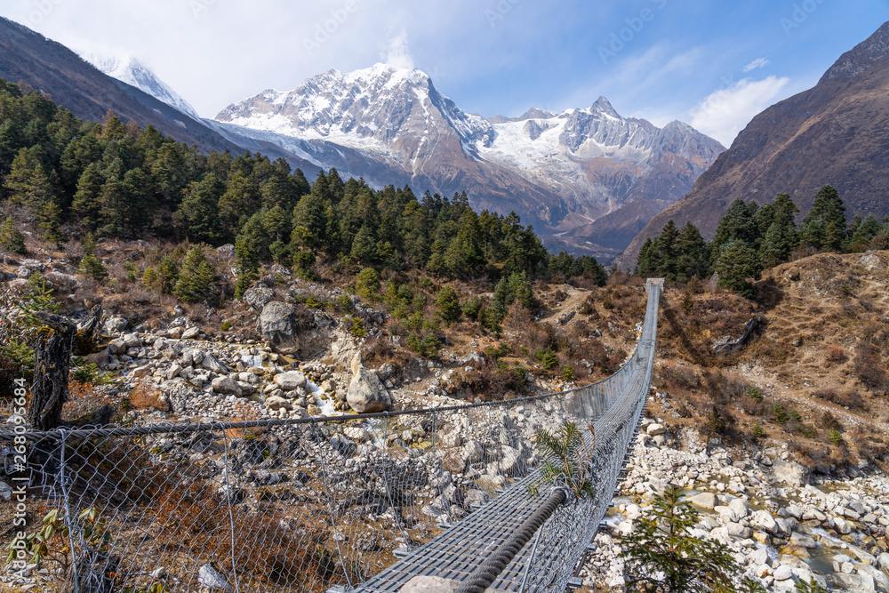 Fototapety, obrazy: Suspenion bridge in Manaslu circuit trekking route, Himalayas mountain range, Nepal