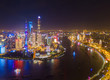 Aerial view of Shanghai Downtown, China. Financial district and business centers in smart city in Asia. Skyscraper and high-rise buildings at night.