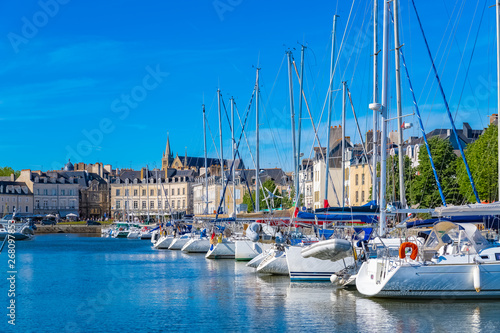 Fotobehang Poort Vannes harbor, in the Morbihan, Brittany, boats in the marina, with typical houses and the cathedral in background