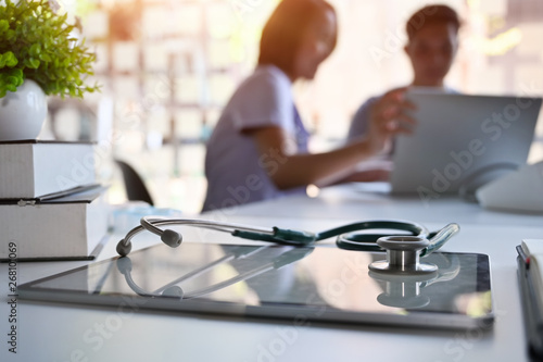 Doctor and patient consult in blur background and medical equipment on hospital workspace Fototapet