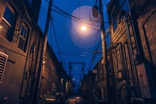 A Dimly Lit Creepy Alley With ...