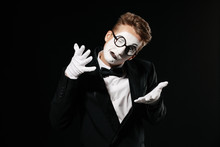 Portrait Of Mime Man In Tuxedo And Glasses On Black Background