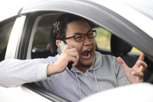 Male Driver Screaming On Phone