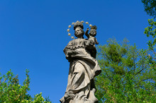 Historical Religious Statue Of Virgin Mary With Jesus ( Madonna ) - Christian Monument And Landmark Is Made Of Stone.