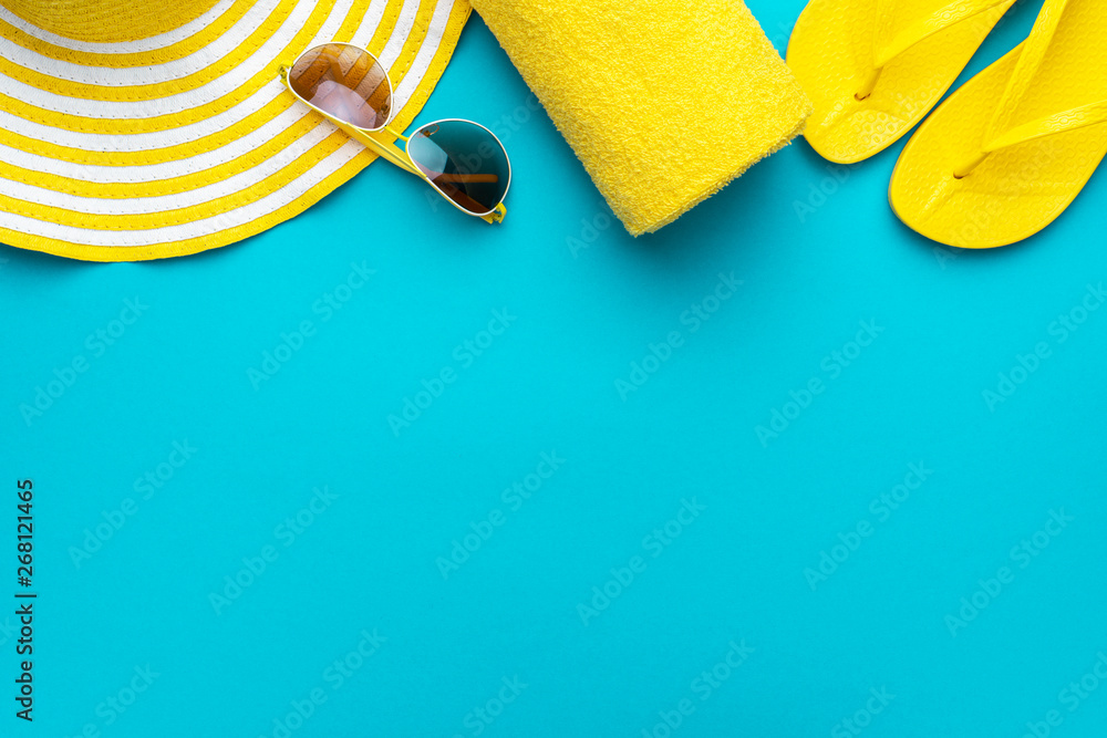 Fototapety, obrazy: yellow beach accessories on turquoise blue background - sunglasses, towel. flip-flops and striped hat. summer is coming concept with copy space. holiday by the sea concept.