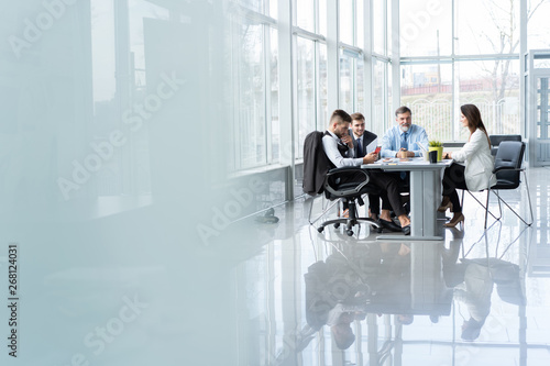 Obraz Businesspeople discussing together in conference room during meeting at office. - fototapety do salonu