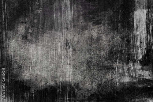 Fotografía  Dark distressed wall grungy background with spotlight background