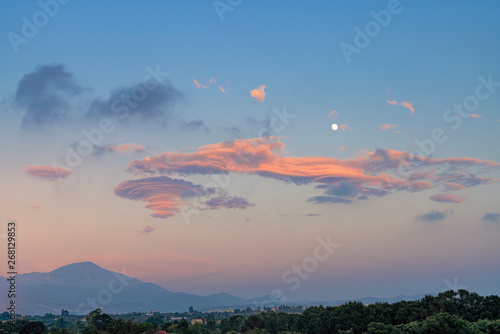 Foto auf Gartenposter Lachs mediterranean evening landscape with the moon and cloudscape