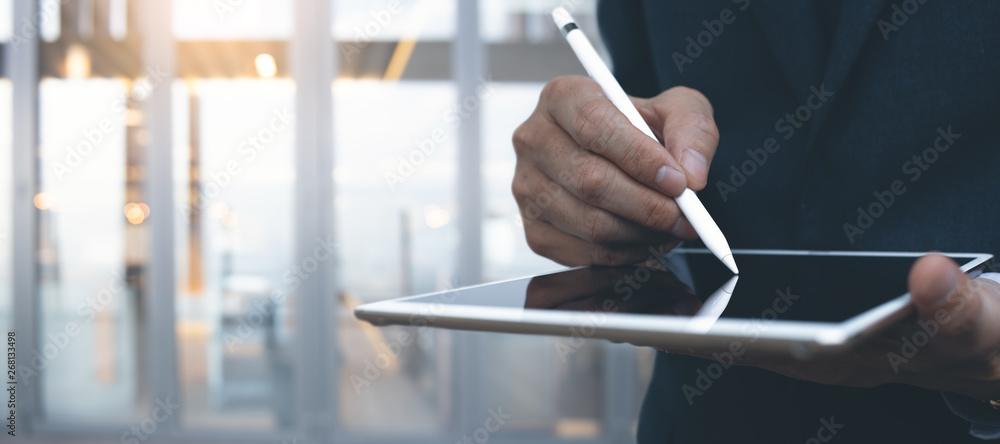 Fototapeta Businessman using digital tablet with stylus
