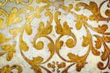 Gold flourish design. White background.