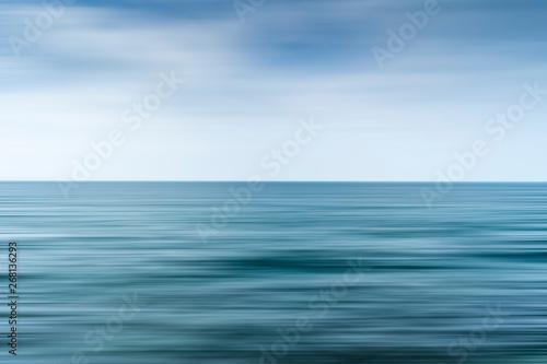 Foto op Aluminium Zee / Oceaan Long exposure shot of clouds over the sea