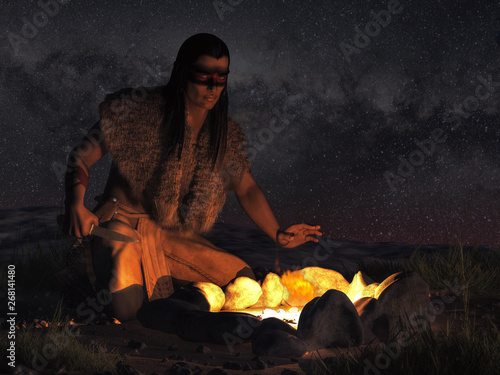A Native American warrior sits by a campfire in the dark of night somewhere in the plains of the American Wild West Canvas Print