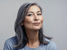 Charming Asian Mature Woman Sm...