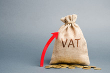 Money Bag And Red Up Arrow. The Concept Of Increasing VAT Tax. Tax Burden On Business Consumers. VAT Refund And Double Taxation Obstruction. Value-added Taxes. Low Tax Rates