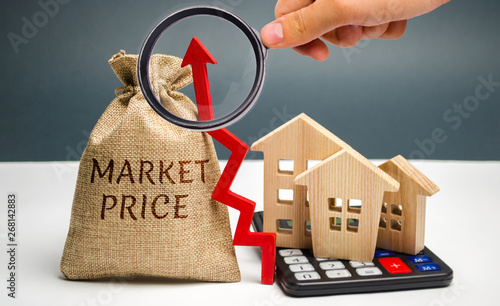 Money bag with the word Market price and an up arrow with a calculator and wooden houses. The concept of increasing housing prices. Rising rent. Real estate market growth