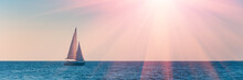 Banner 3:1. Sailboat In The Sea In The Evening Sunlight Over Sky Background. Luxury Summer Adventure Or Active Vacation Concept. Copy Space.